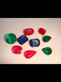 Emeralds, Ruby, and Blue Sapphire cut stones