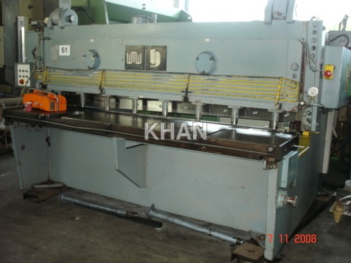 Sheet cutting machines