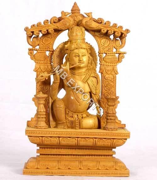 wooden krishna god statue