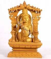wooden krishna god statue
