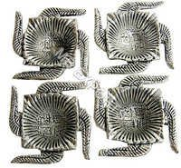 White Metal Swastik Shape  Diya