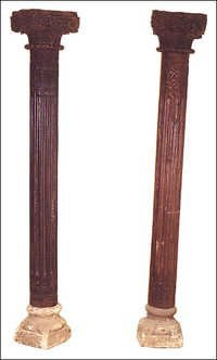 TEAK PAIR OF ETHNIC PILLARS ON STONE BASES