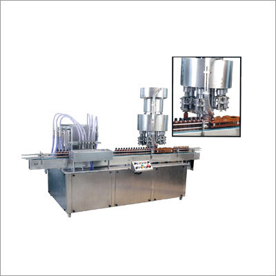 Automatic Bottle Filling & Capping Machine (Monobl