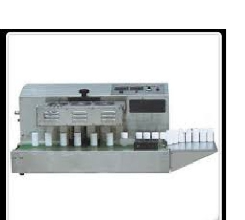 Continuous induction sealer with conveyor