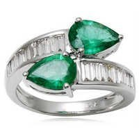 White Gold pear cut Emerald studded Baguette Ring