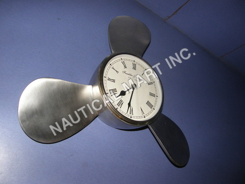 VINTAGE ALUMINUM FAN SHAPED WALL CLOCK
