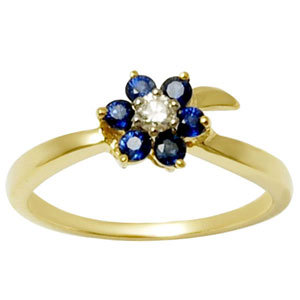 small gold ring in blue sapphire