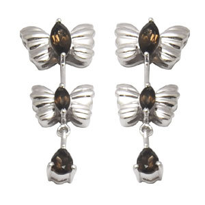 butterfly shaped silver earrings with smokey