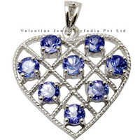 heart shaped designer gold pendant in tanzanite