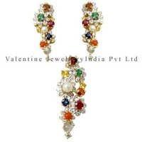 navratna pendant and earrings set in white gold