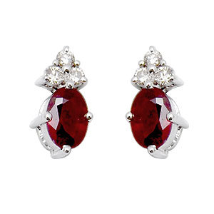 cute earrings in ruby and diamonds in white gold from india