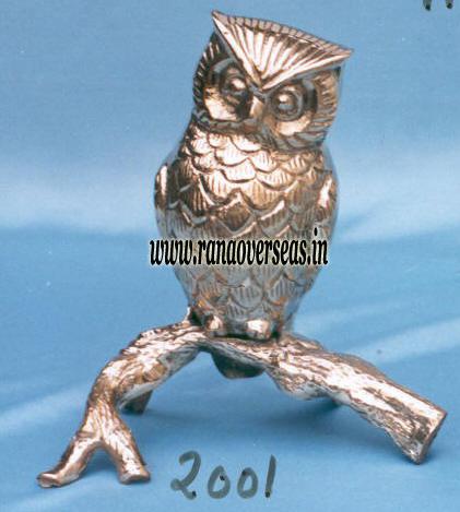 Brass Metal Owl Sitting on Brass Leaves