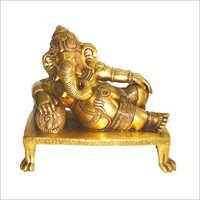 God Ganesh lying on pillow