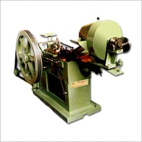 Automatic Bolt Head Trimming & Shank Reducing Machine