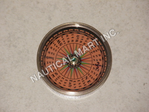 NAUTICAL BRASS COMPASS WITH ORANGE BASE.