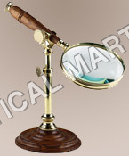 NAUTICAL MAGNIFYING GLASS WITH STAND.