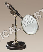 NAUTICAL MAGNIFYING GLASS WITH BRONZED STAND.