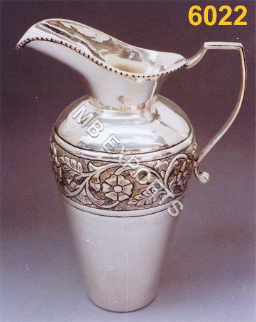 Metal jug with design