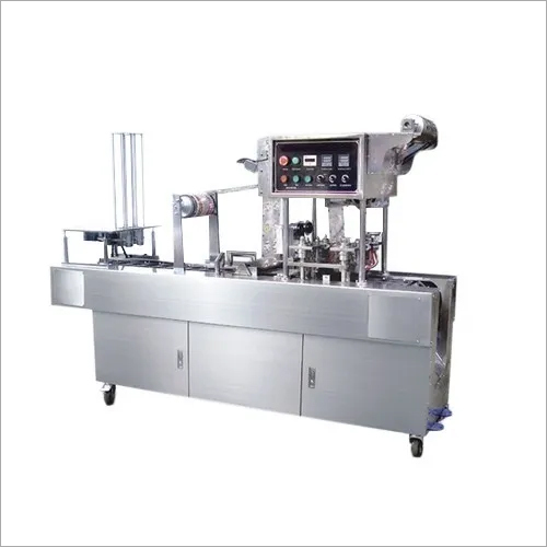 Automatic curd cup packing machine