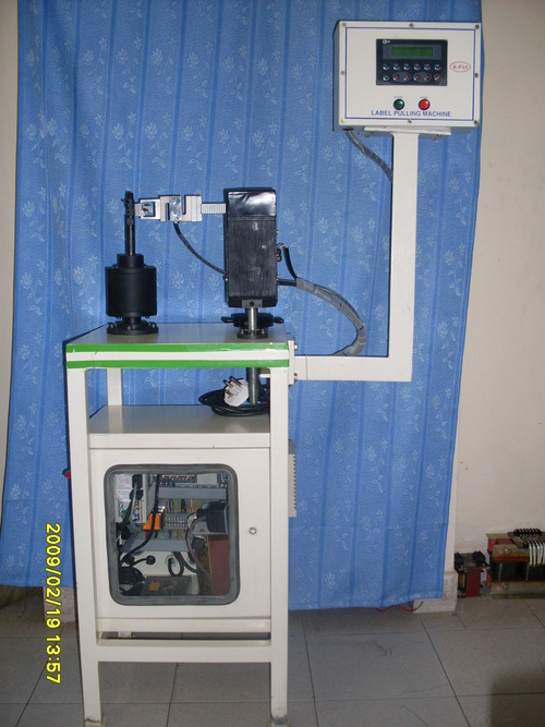 Label pulling machine