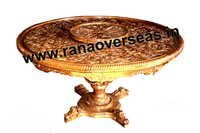 Wooden Hand Carved Center Table in Round Shape.