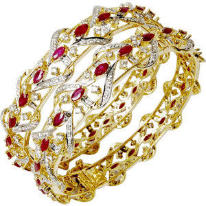 New design heavy gemstone studded 18k gold bangles