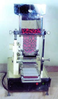 CAPSULE LOADING MACHINE