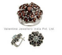 designer ring and earring set studded with garnet onyx and blue topaz as costume set jewellery