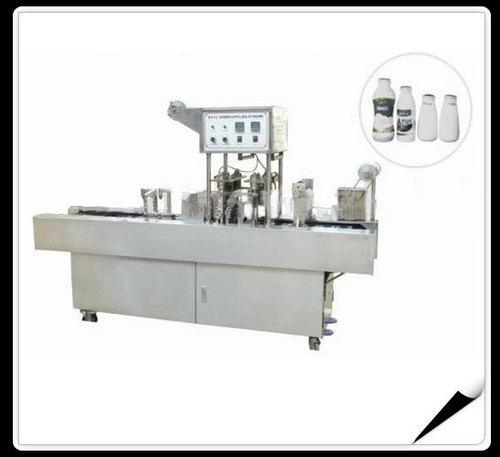 Automatic Milk Bottles Filling and Sealing Machi      ne sps48S