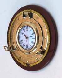 BRASS PORTHOLE  CLOCK WITH ROPE AND WOOD  11.5