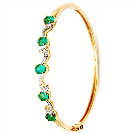 Delicate Waves Oval Emerald Half Bangle Collection