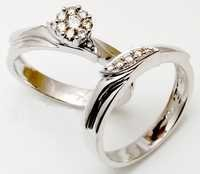 couple wedding jewelry rings in white gold and diamonds