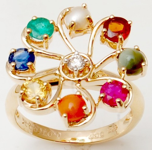 luck enhancer ring in 18k gold with precious stones from valentine