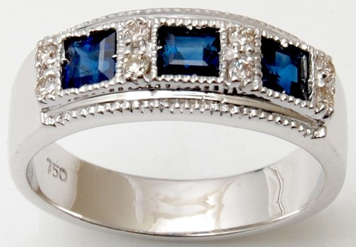 three stone ring with princess cut sapphire and brilliant cut diamond