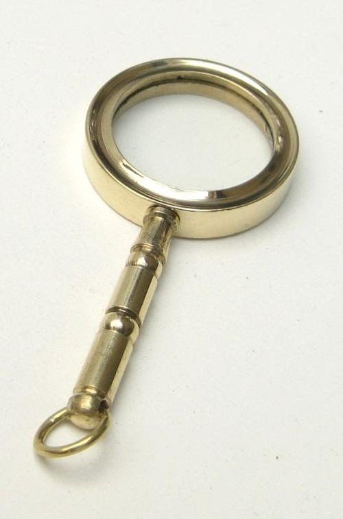 Miniature brass magnifying glass