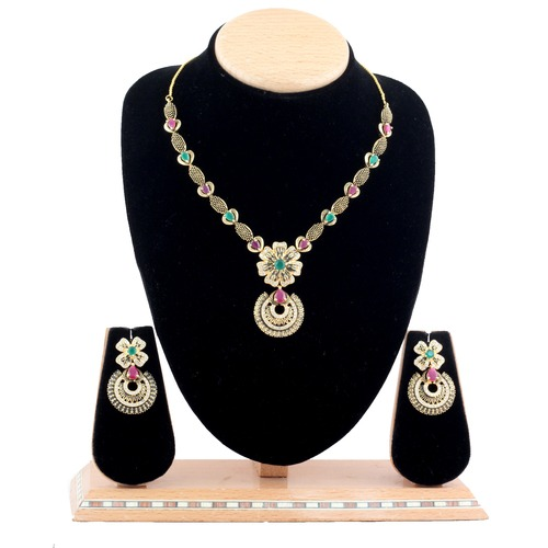 Diamond Necklace Set with Emerald stone.