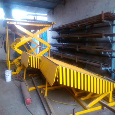 Dock leveler with scissor lift