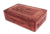 An Intricately Hand Carved Decorative Box With Red Velvet Interiors