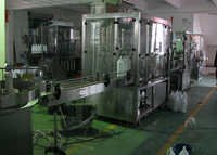 Volumetric Linear Bottle Filling Machine