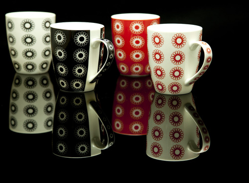 Nucleus lines coffee mug in a matching sleeve