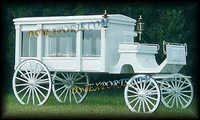 White Covered Horse Drawn Carriages