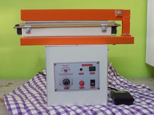 Sanitary Napkin Sealing Embossing Machine