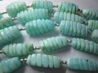 Peru opal carved twisted beads