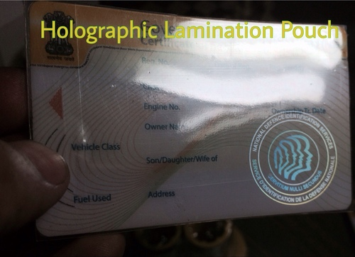 Holographic lamination pouch for paper and plastic cards