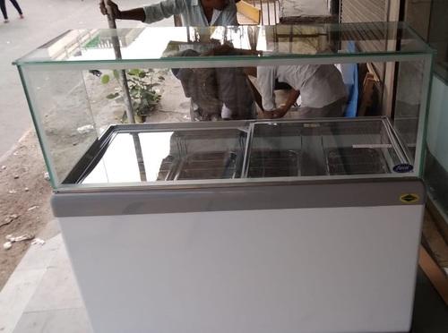 CANOPIES OVER GLASS TOP ICE CREAM FREEZERS