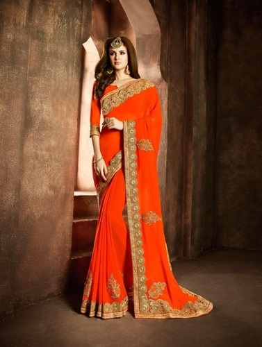 orange designer georgette saree with heavy border