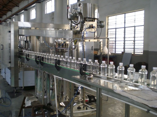 Jar/ Tin Bottle Filling Machine