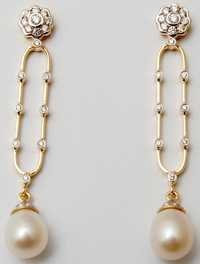 graceful light and long pearl earrings