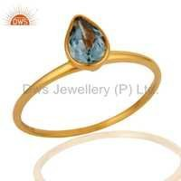 9K Yellow Gold Pear Shaped Blue Topaz Ring
