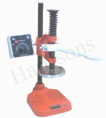 Foil Sealer & Tagger Sealing Machine